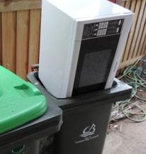 Microwave in garbage