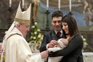 Pope-Francis-baptises-one-of-32-babies-during-a-mass-in-the-Sistine-Chapel