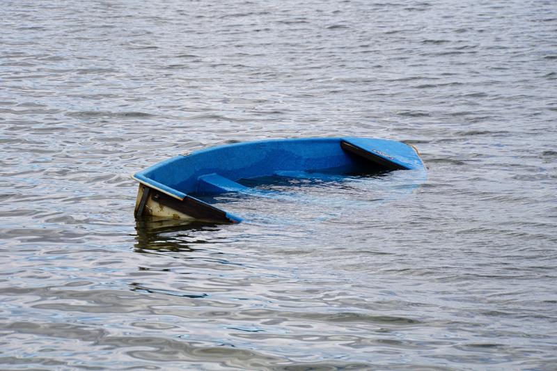 Sinking Blue Boat